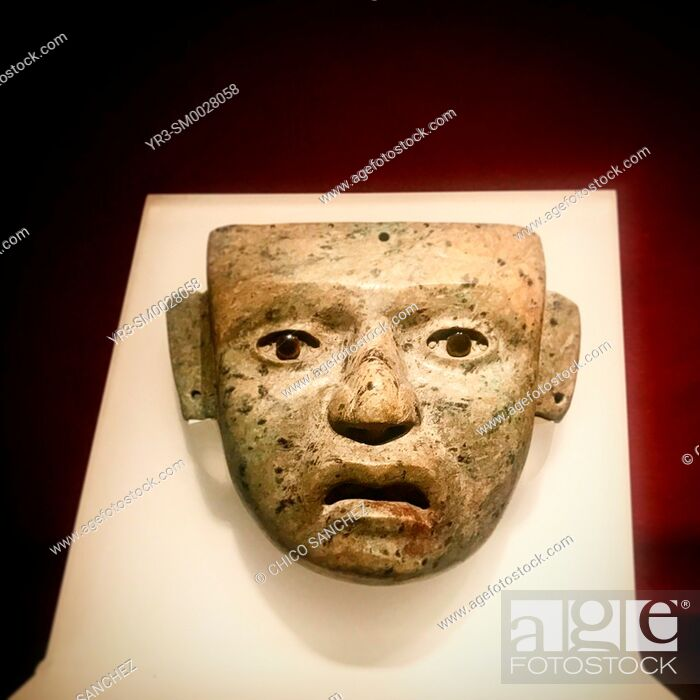 Stock Photo: A mask of a human person decorates Templo Mayor museum im Mexico City, Mexico.