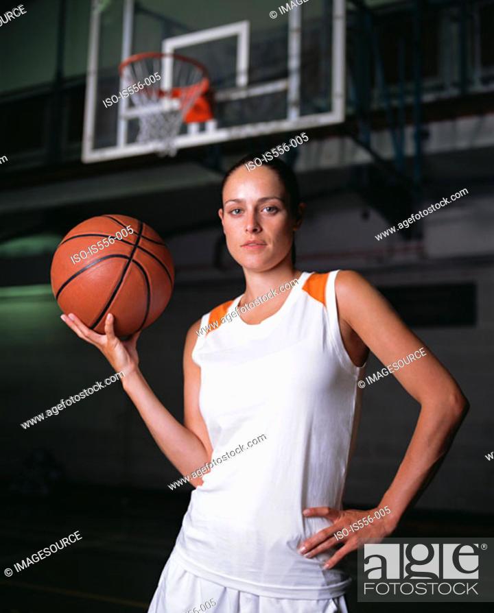 Stock Photo: Female basketball player.