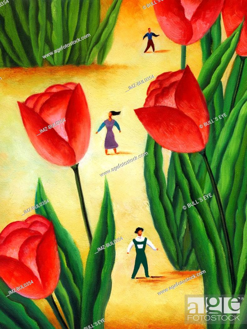 Stock Photo: People walking amongst large tulips.