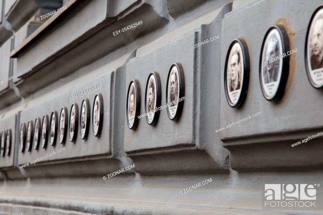 Stock Photo: BUDAPEST, HUBUDAPEST, HUNGARY - JUNE 19, 2014: Photos of victims of fascist and communist regimes outside House of Terror, Budapest.