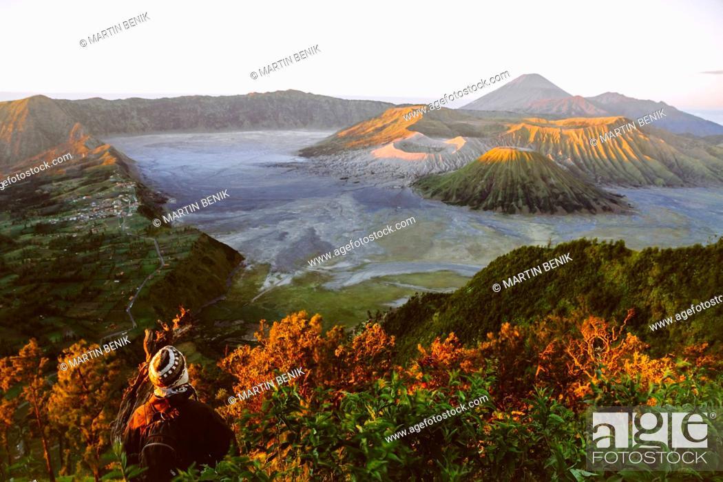 Stock Photo: Indonesia, Java, Bromo Tengger Semeru National Park, Tourist looking down to Bromo Volcano.