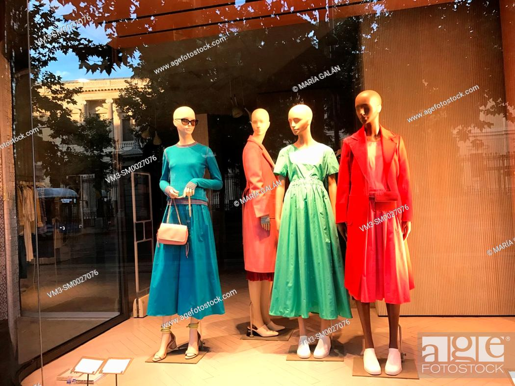 Stock Photo: Four mannequins in a shop window. Madrid, Spain.