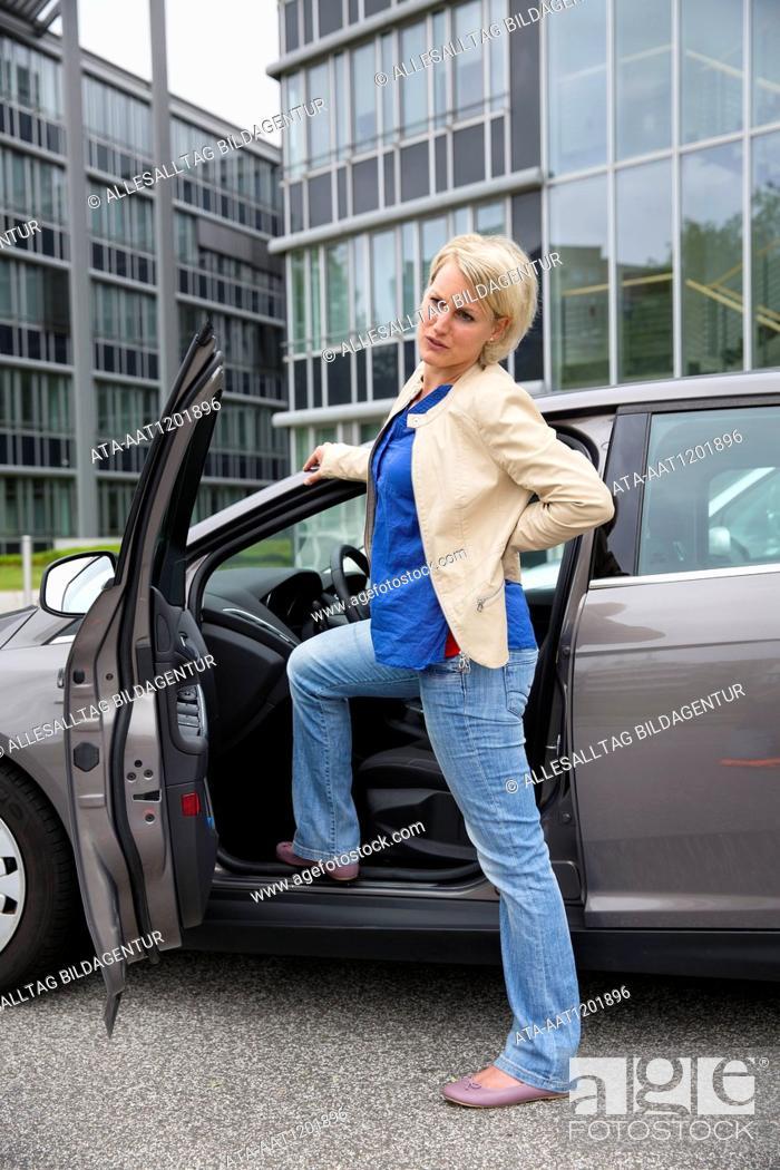 Stock Photo: Female car driver has backache.