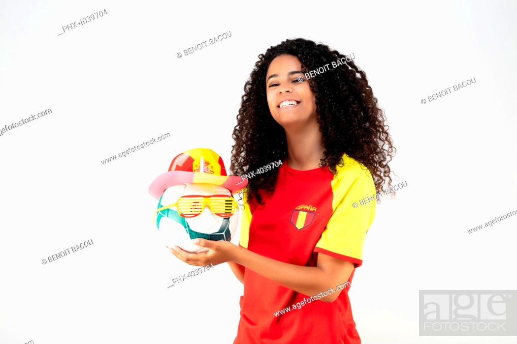 Stock Photo: Portrait of a young supporter of the Spanish team a ball in his hands.