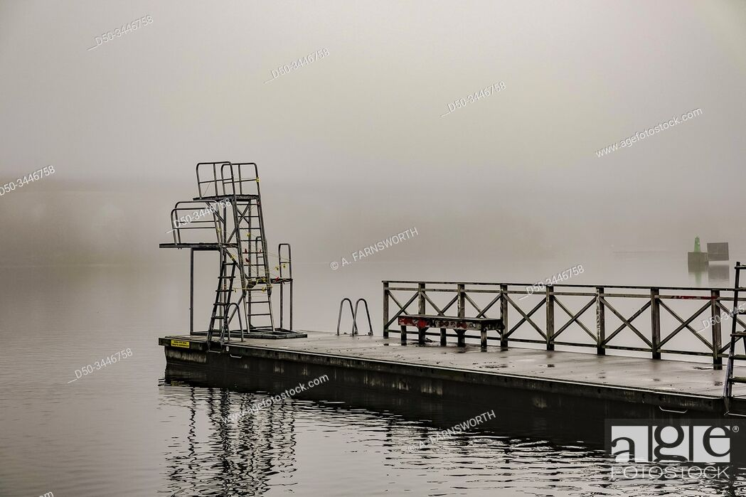 Stock Photo: Stockholm, Sweden A diving platform in the fog at Tantolunden park.