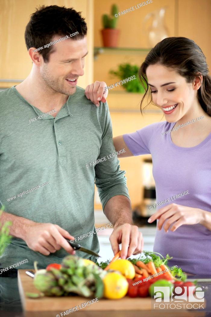 Stock Photo: Couple cooking in the kitchen.