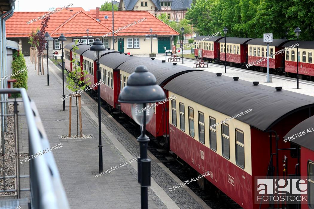 Stock Photo: 16 May 2020, Saxony-Anhalt, Wernigerode: HSB passenger coaches are located at the main station in Wernigerode. The Harz narrow-gauge railways are again running.