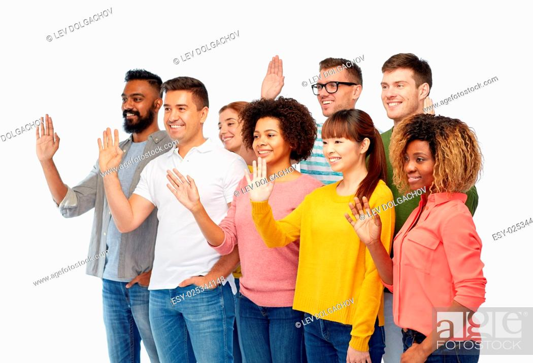 Stock Photo: diversity, race, ethnicity and people concept - international group of happy smiling men and women waving hand over white.
