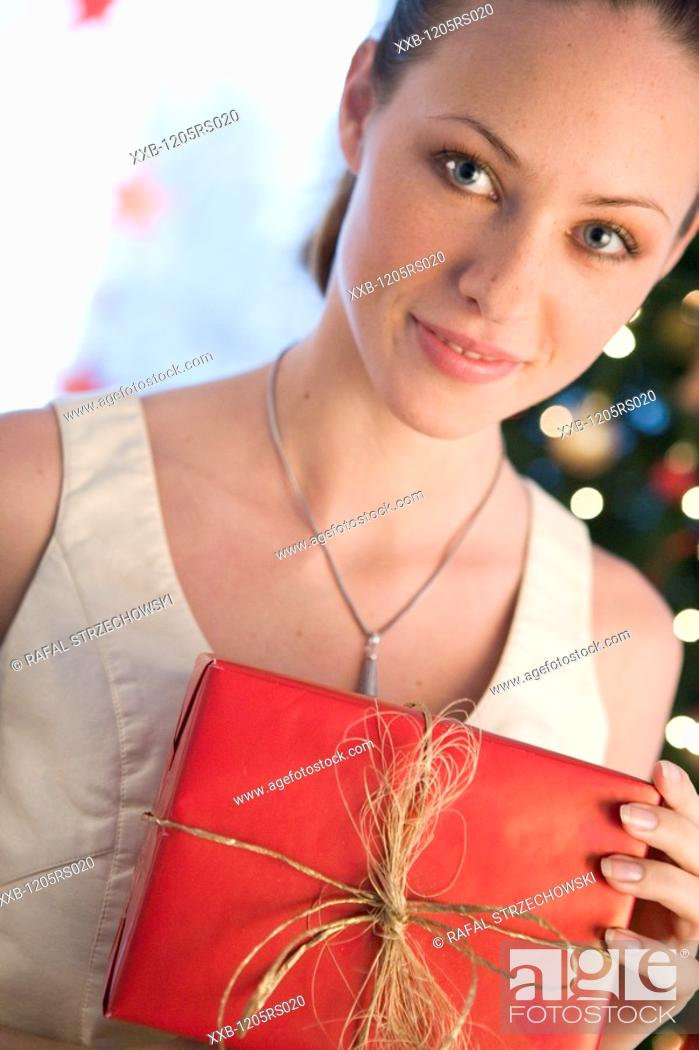 Stock Photo: portrait of a woman with christmas gift.