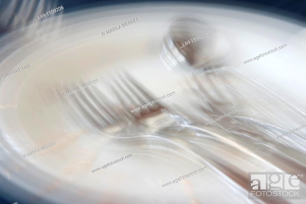 Stock Photo: Plate and cutlery after meal.