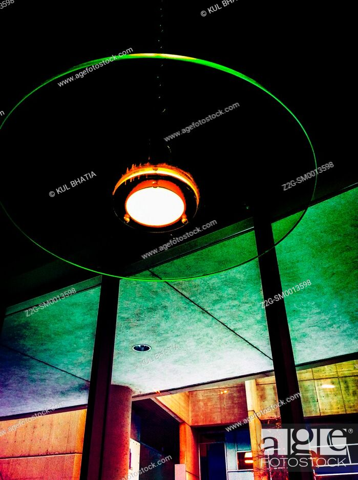 Stock Photo: A round ceiling light fixture inside a pub in a contemporary building, Ontario, Canada.