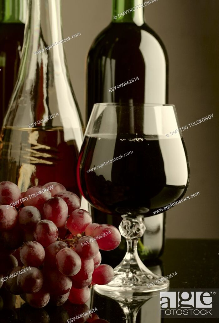 Imagen: Old wine  Still life with wine bottles and goblet.