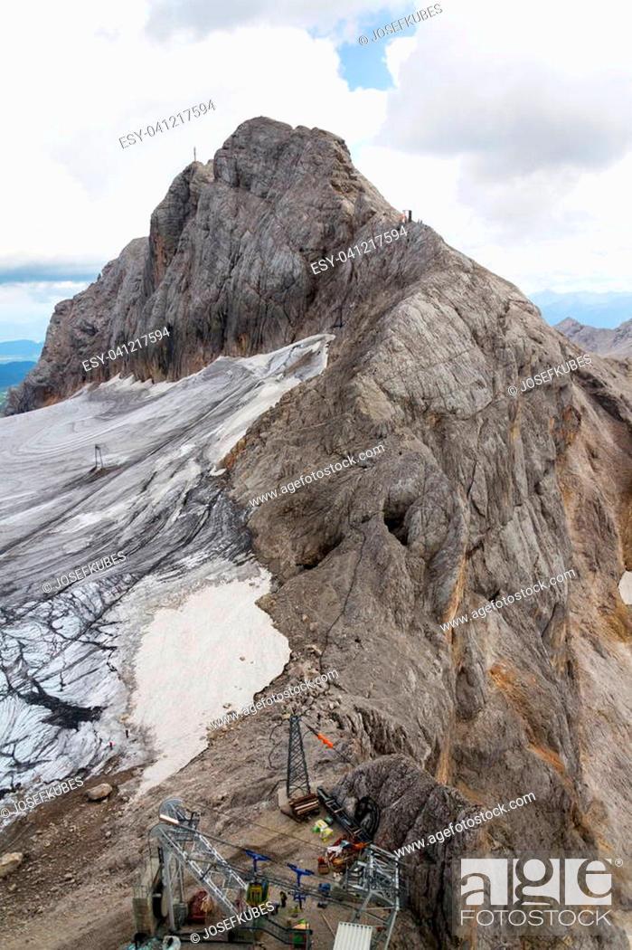 Stock Photo: People climbing via Koppenkarstein ferrata near Dachstein glacier, Austrian Alps.