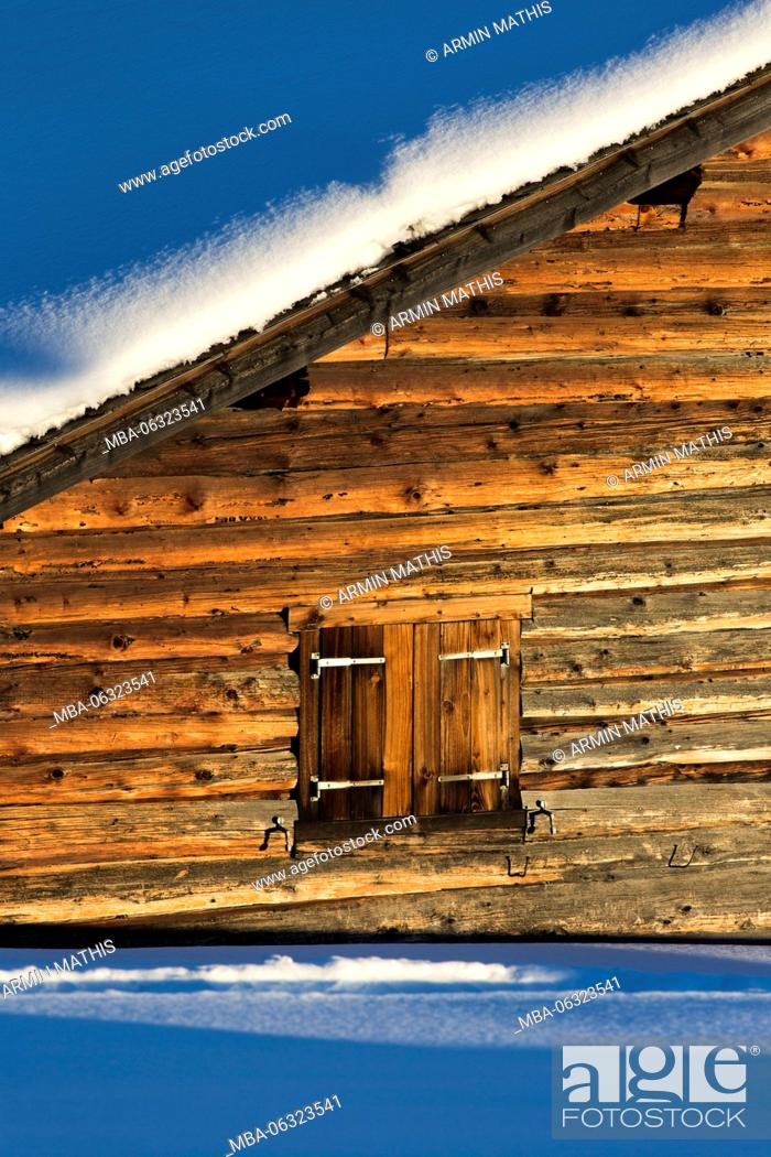 Stock Photo: The afternoon sun shines on the houses at the Wiesner Alp in Canton of Grisons.