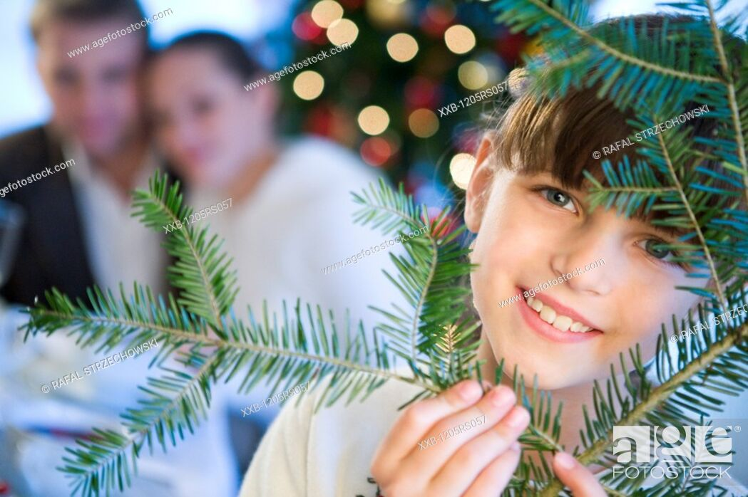 Stock Photo: daughter with parents near christmas tree.