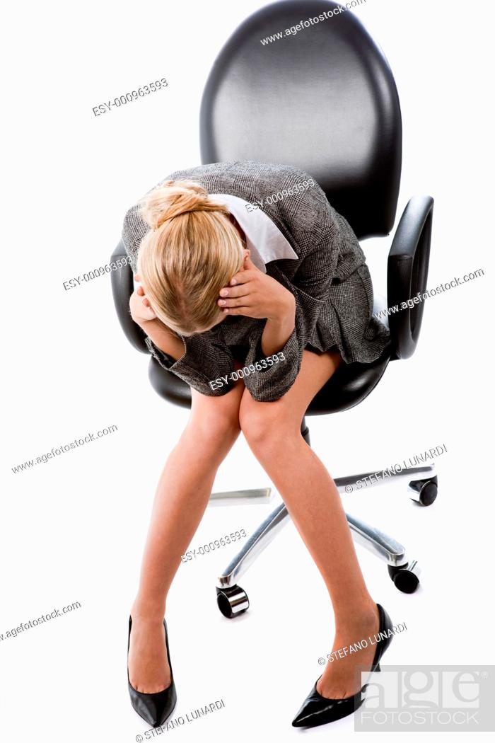 Stock Photo: Businesswoman with hands on head in expression of crisis, frustration or worry.