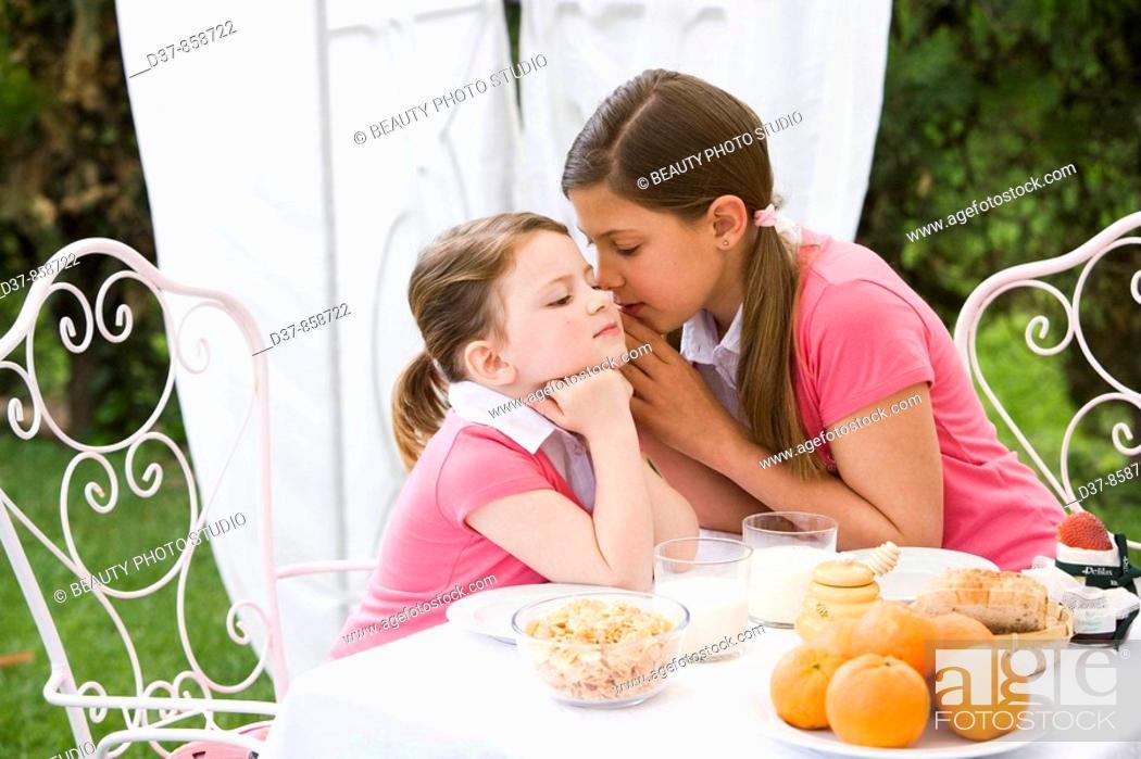 Stock Photo: Girl whispering a secret.