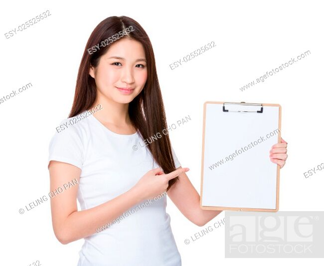 Stock Photo: Asian young woman finger point to blank page of clipboard.
