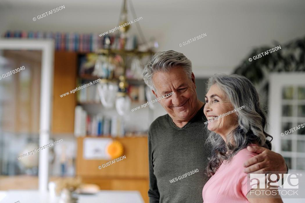 Stock Photo: Portrait of a happy senior couple at home.