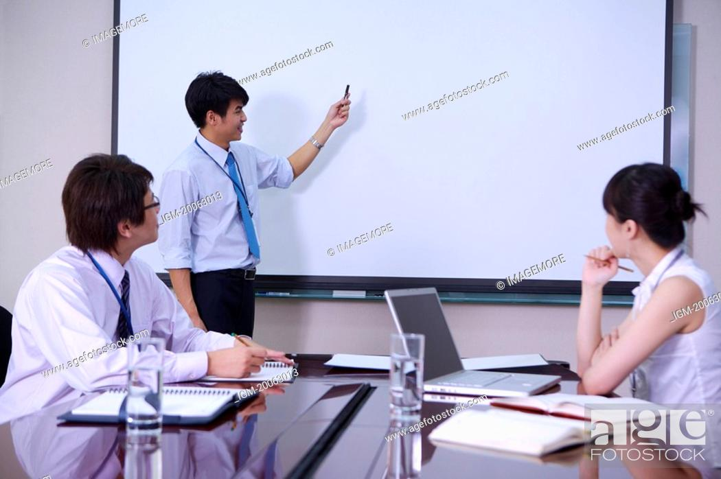 Stock Photo: Young woman and men having a meeting together.
