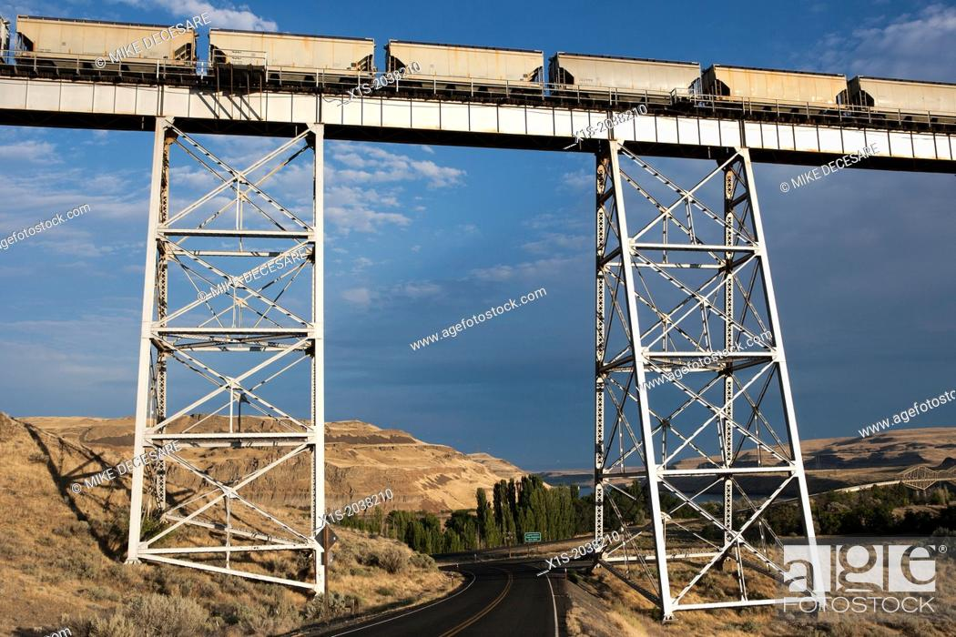 Stock Photo: Long and high railroad tressle spans a river valley.