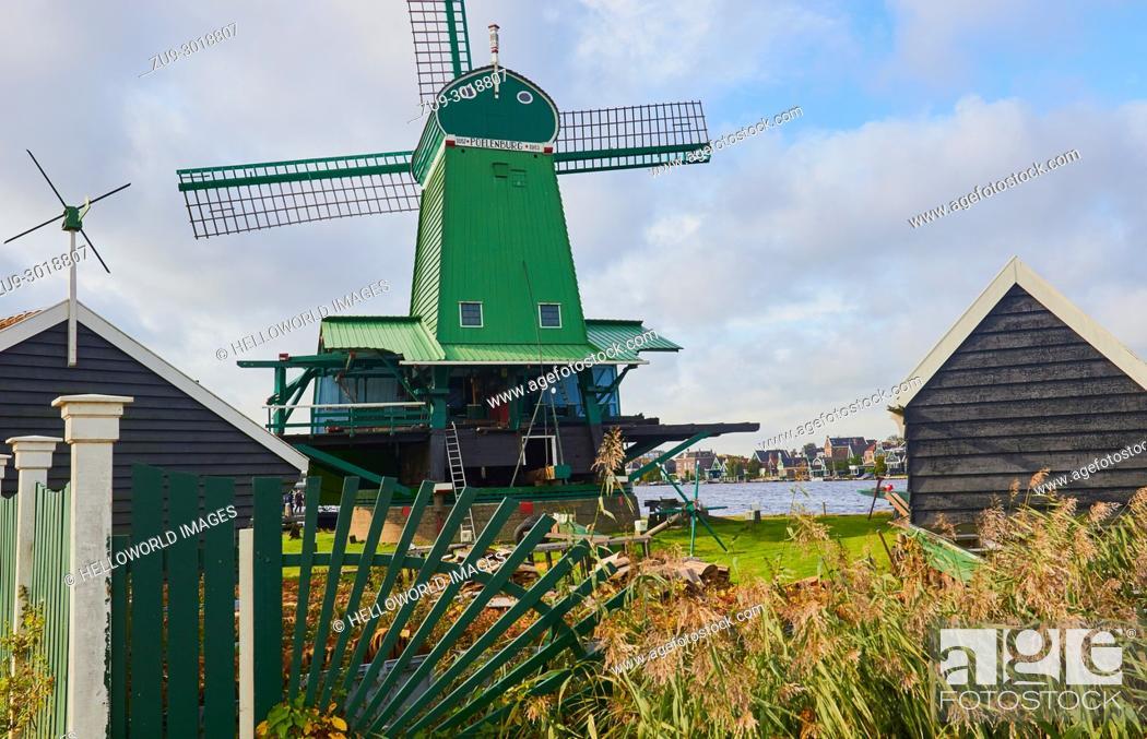 Photo de stock: De Poelenburg a paltrok or post mill, Zaanse Schans a village near Zaandijk in the municipality of Zaanstad, North Holland, Netherlands.