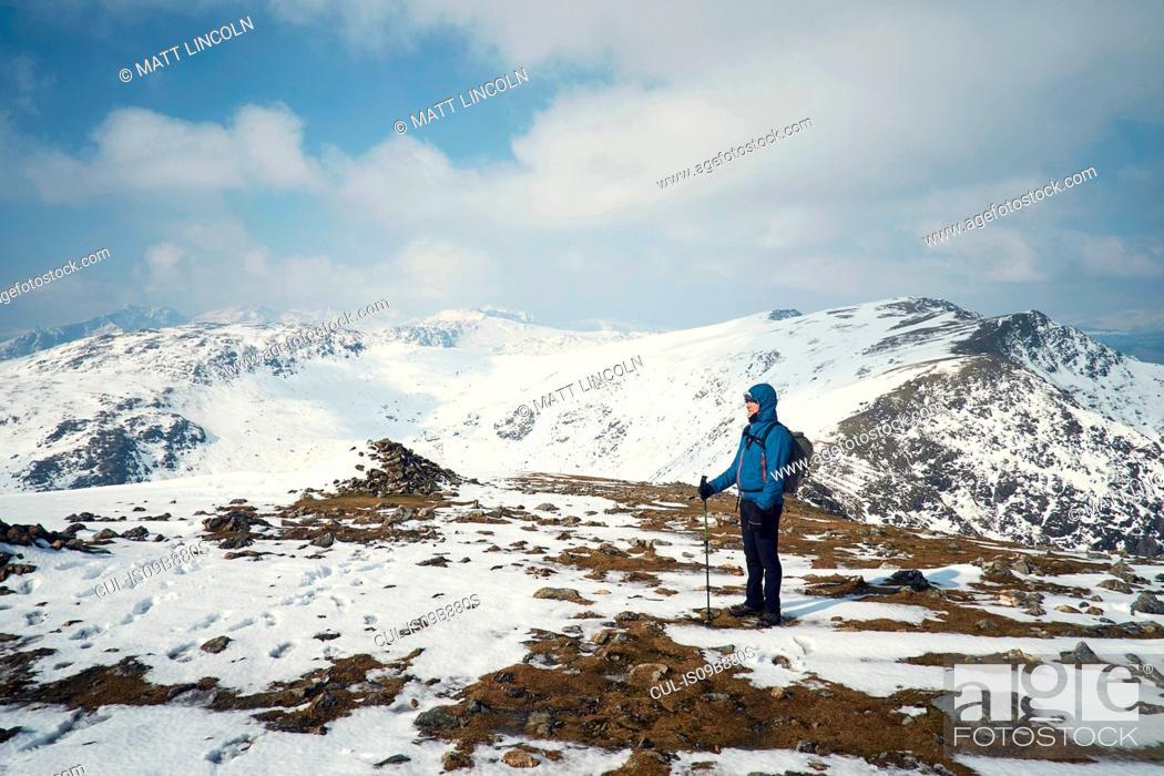Stock Photo: Hiker on snow-covered mountain, Coniston, Cumbria, United Kingdom.