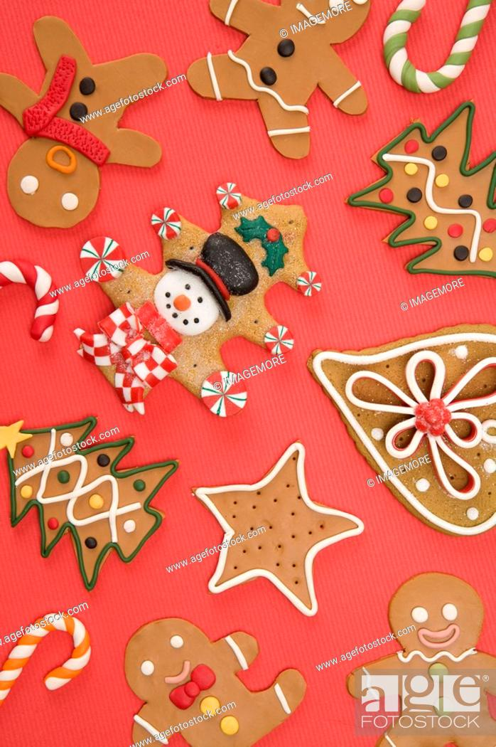 Stock Photo: Gingerbread Cookie on red background.
