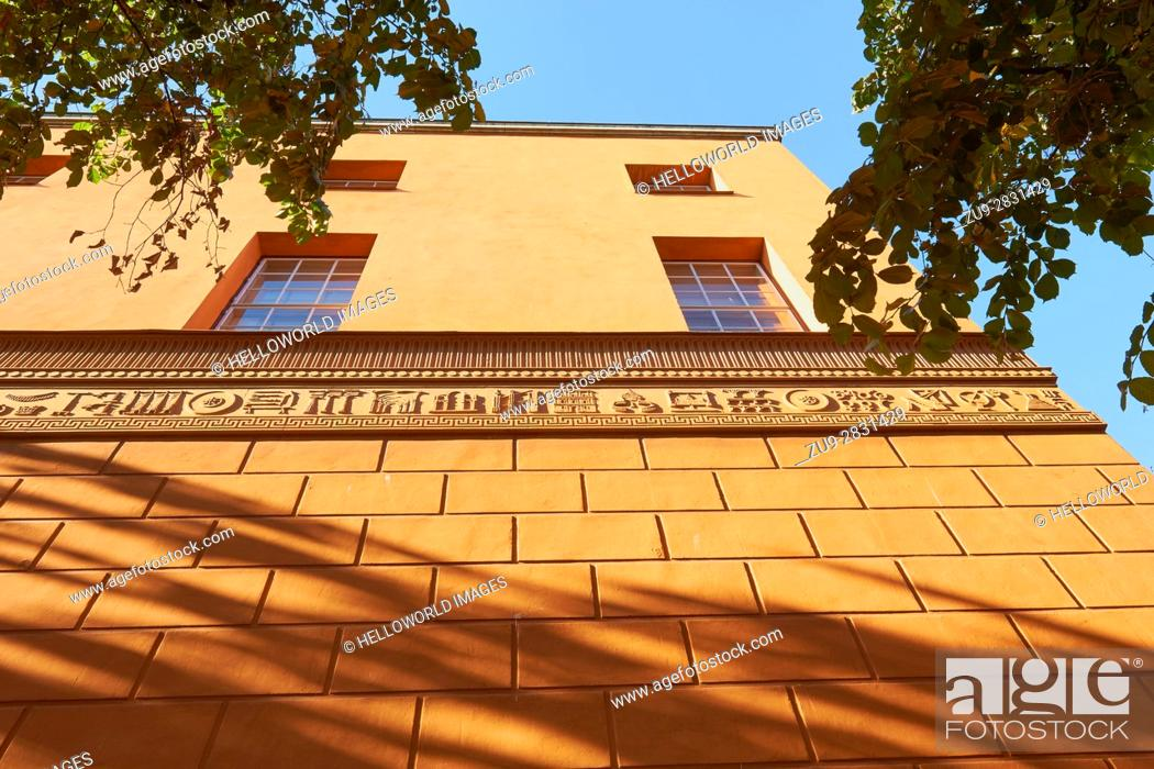 Stock Photo: Orange decorative facade of Stadsbibliotek (Stockholm Public Library), designed by Swedish architect Gunnar Asplund (1928), Stockholm, Sweden, Scandinavia.