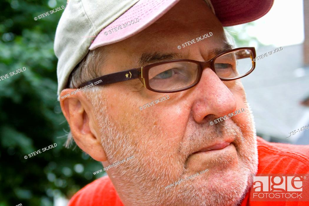 Stock Photo: Steve Skjold a wizened old photographer with a serious demeanor  Clitherall Minnesota MN USA.