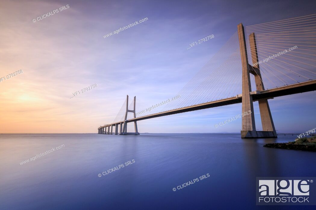 Stock Photo: The colors of dawn on Vasco da Gama Bridge that spans the Tagus River in Parque das Nações Lisbon Portugal Europe.