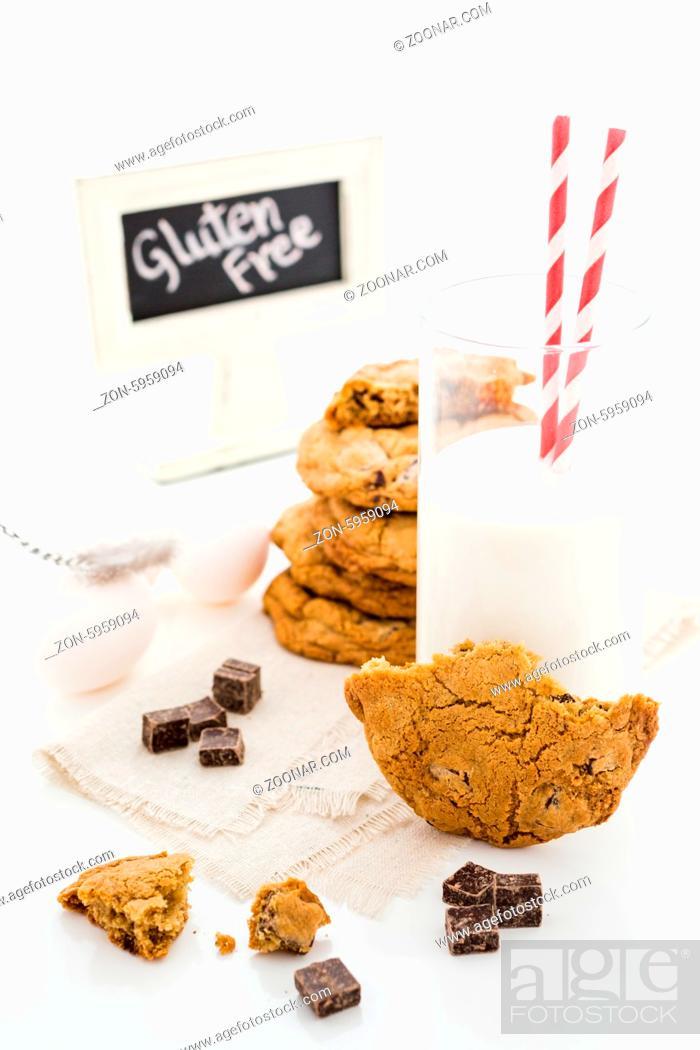 Stock Photo: Gluten free chocolate chunk cookies with glass of milk.