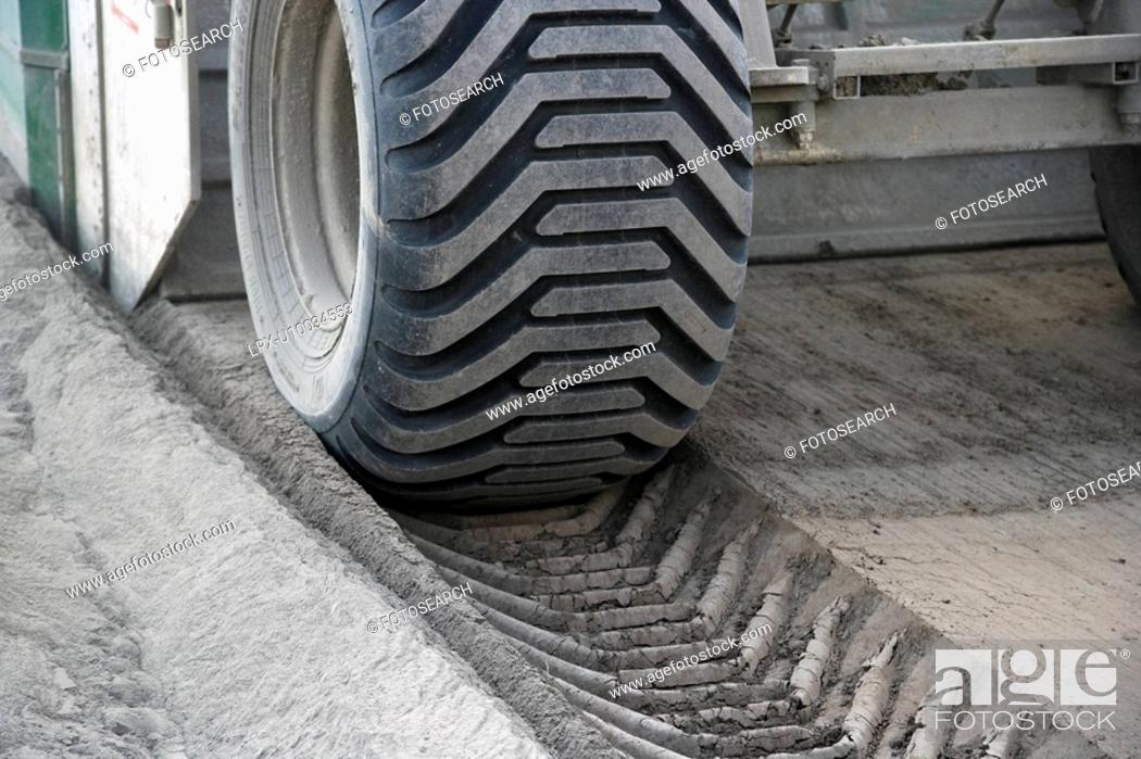 Stock Photo: View of large truck wheel, road building operations.