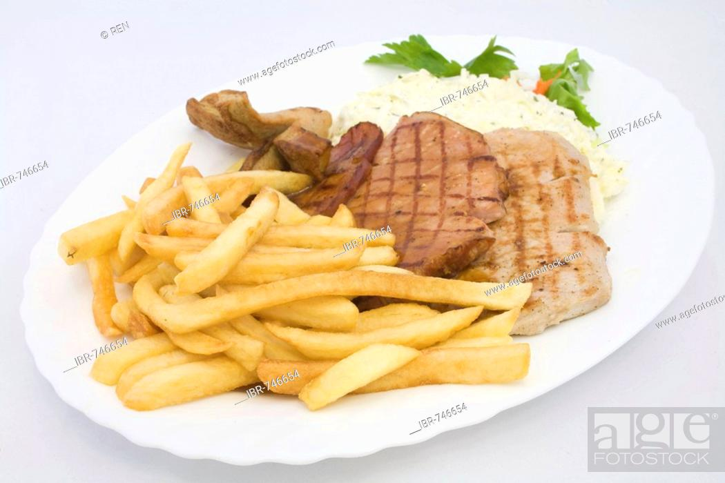 Stock Photo: Grilled cutlets served with coleslaw and french fries.