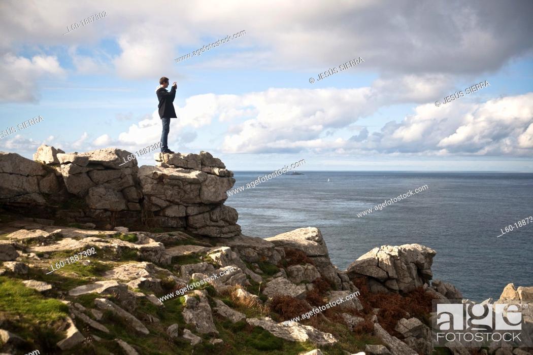 Stock Photo: Tourist in Point du Raz, France.