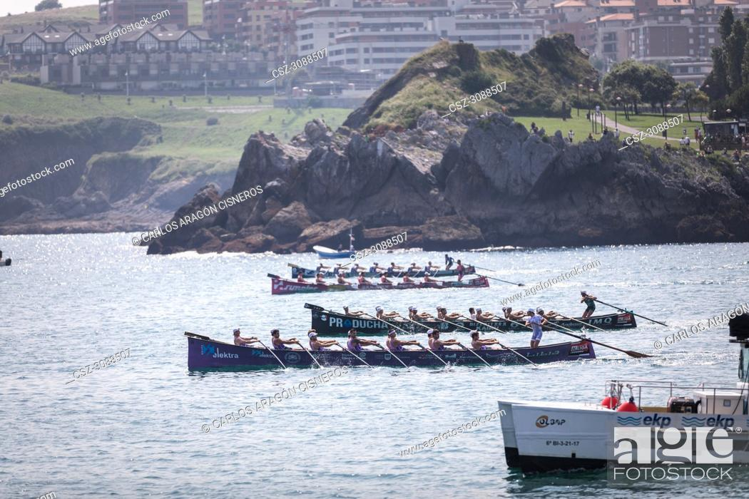 Stock Photo: CASTRO URDIALES, SPAIN - JULY 15, 2018: Start competition of boats, regata of trainera, San Pedro, Kaiku, San Juan and Tiran boats in action in the VI Bandera.