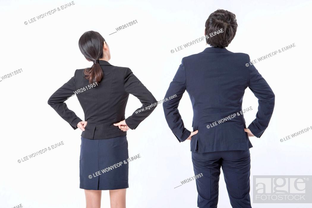 Imagen: Backs of business people stretching.