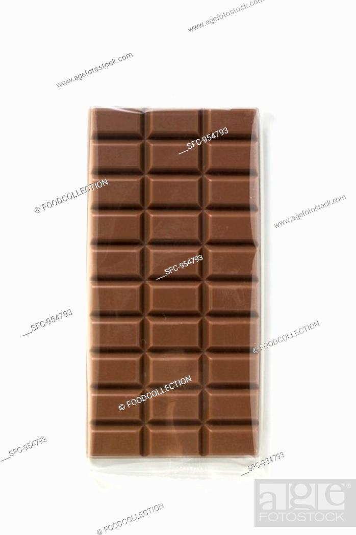 Stock Photo: A bar of milk chocolate in cellophane.