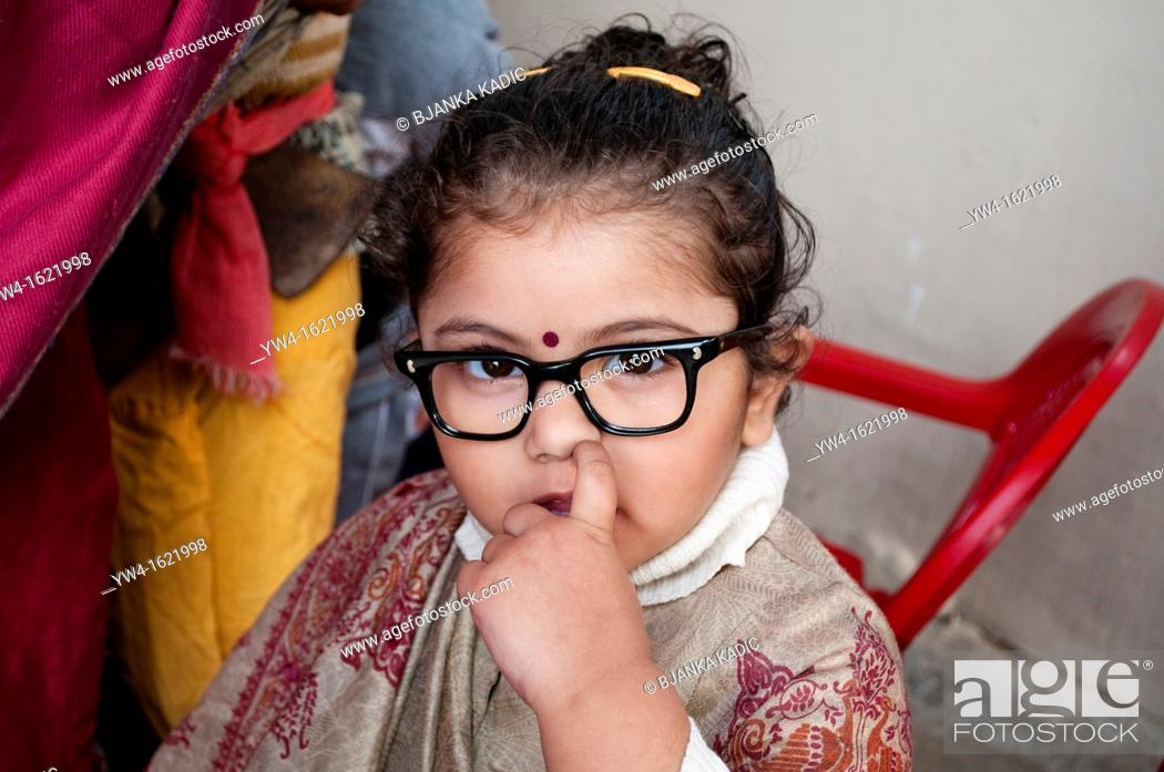 Stock Photo: Nursery school - girl dressed up as a teacher picking her nose, Chandigarh, India.