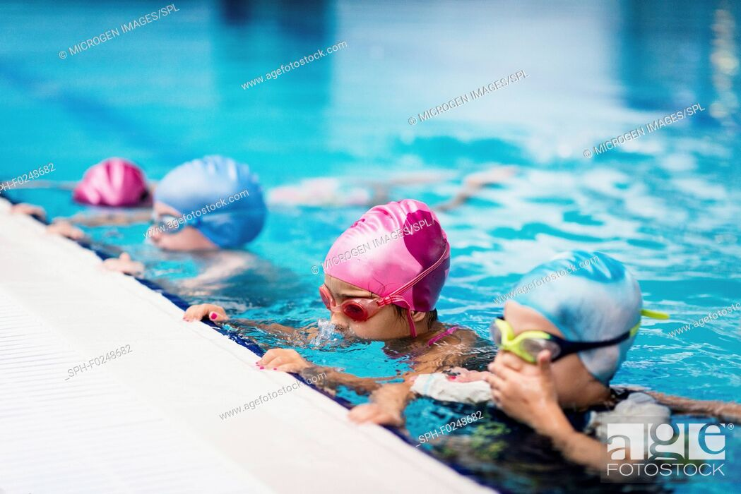 Stock Photo: Group of children in swimming class, making bubbles.