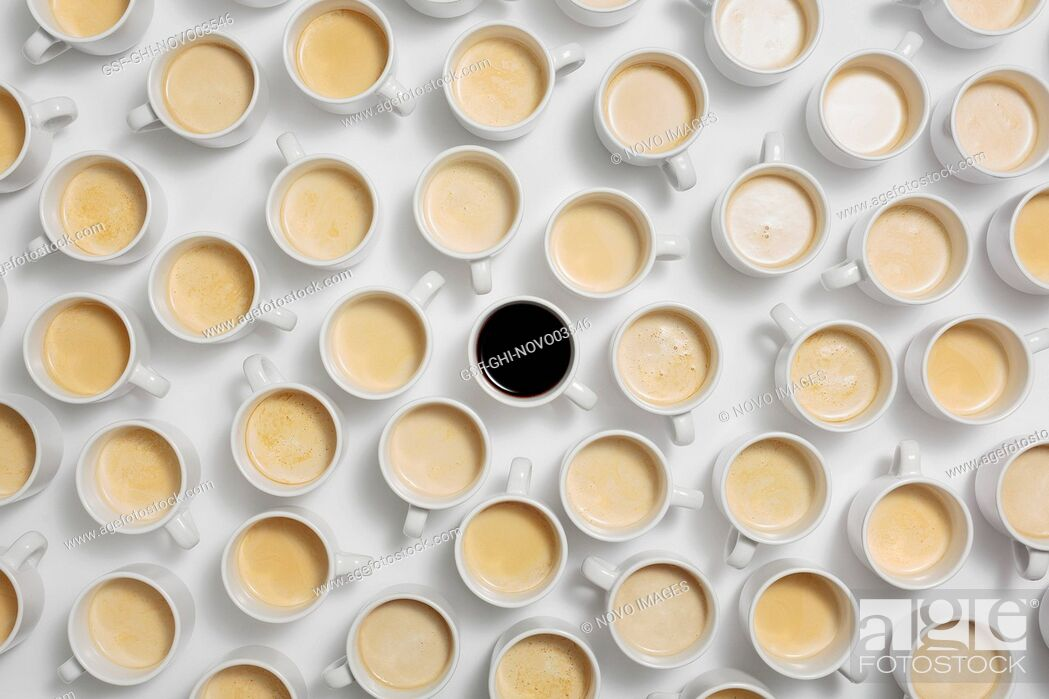Stock Photo: High Angle View of Cups of Coffee Filled with Milk and Center Cup Filled with Black Coffee.