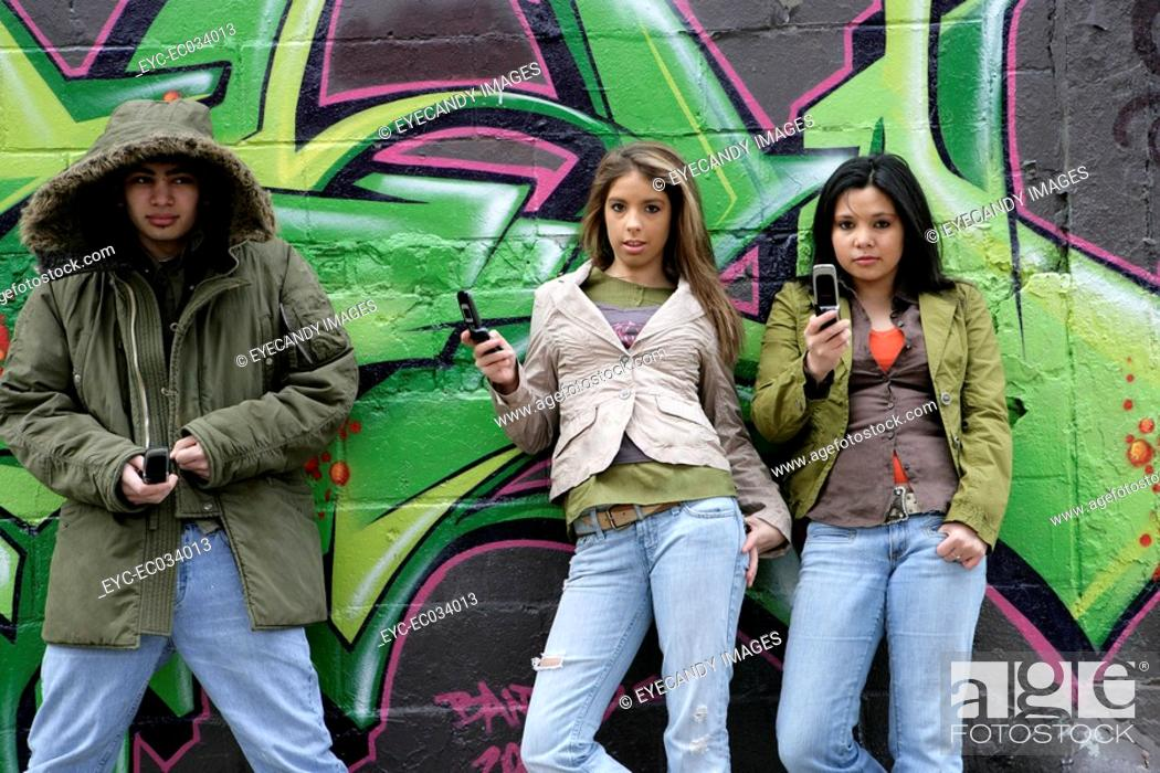 Stock Photo: View of three people with cellphones.