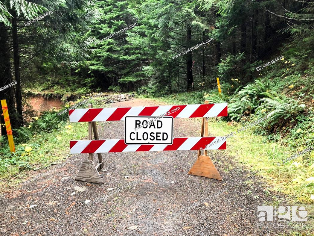 Stock Photo: Road closed in the Umpqua National Forest of Oregon because of a large landslide that took out this forest service BLM road.