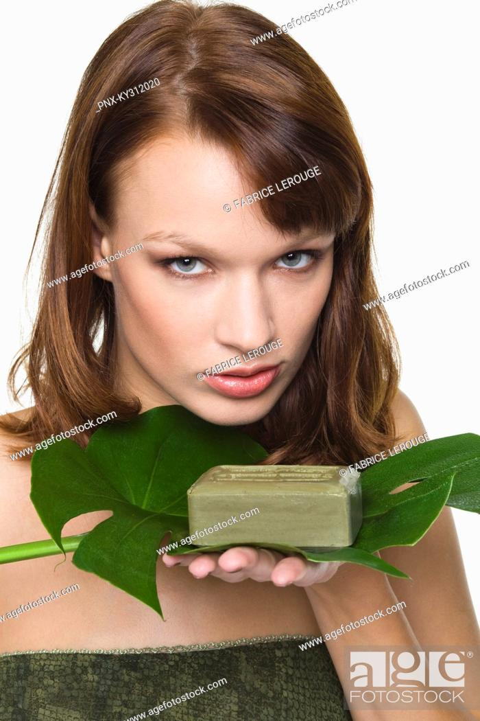 Stock Photo: Young woman holding olive oil soap.