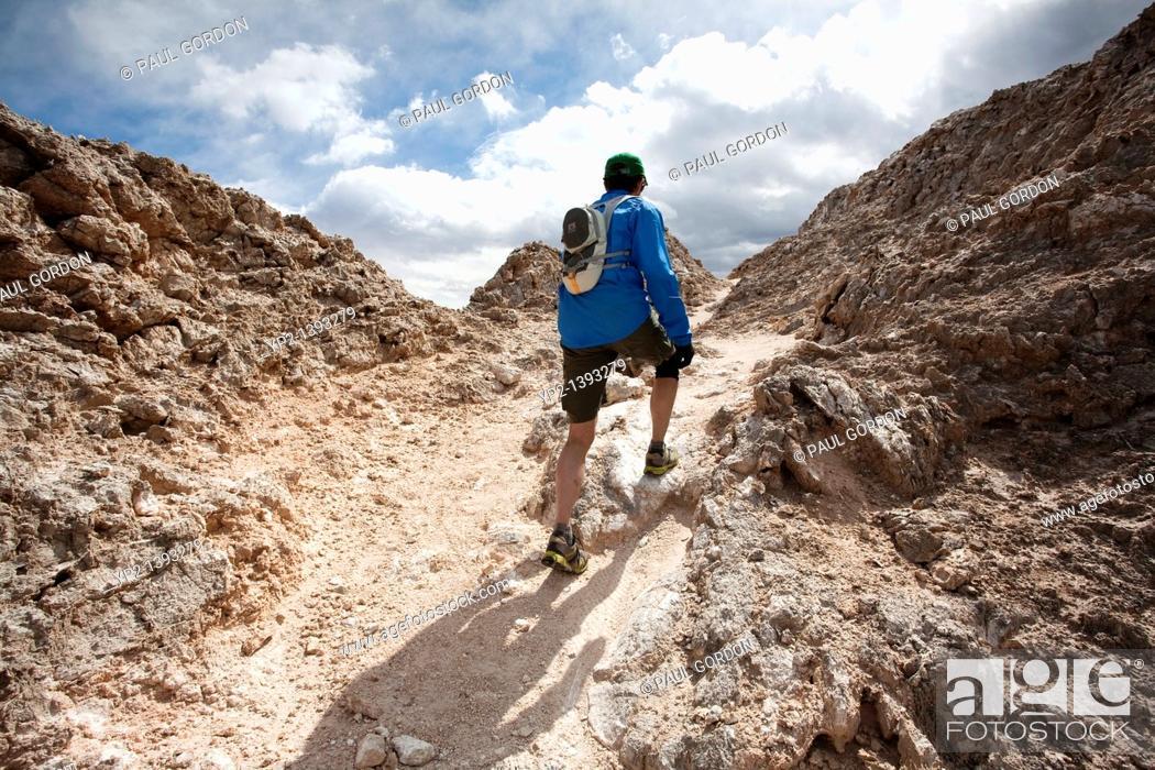 runner hiking along the white mesa bike trails area ojito