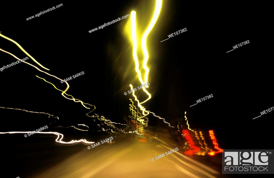 Stock Photo: Blurred tail lights of highway traffic at night.