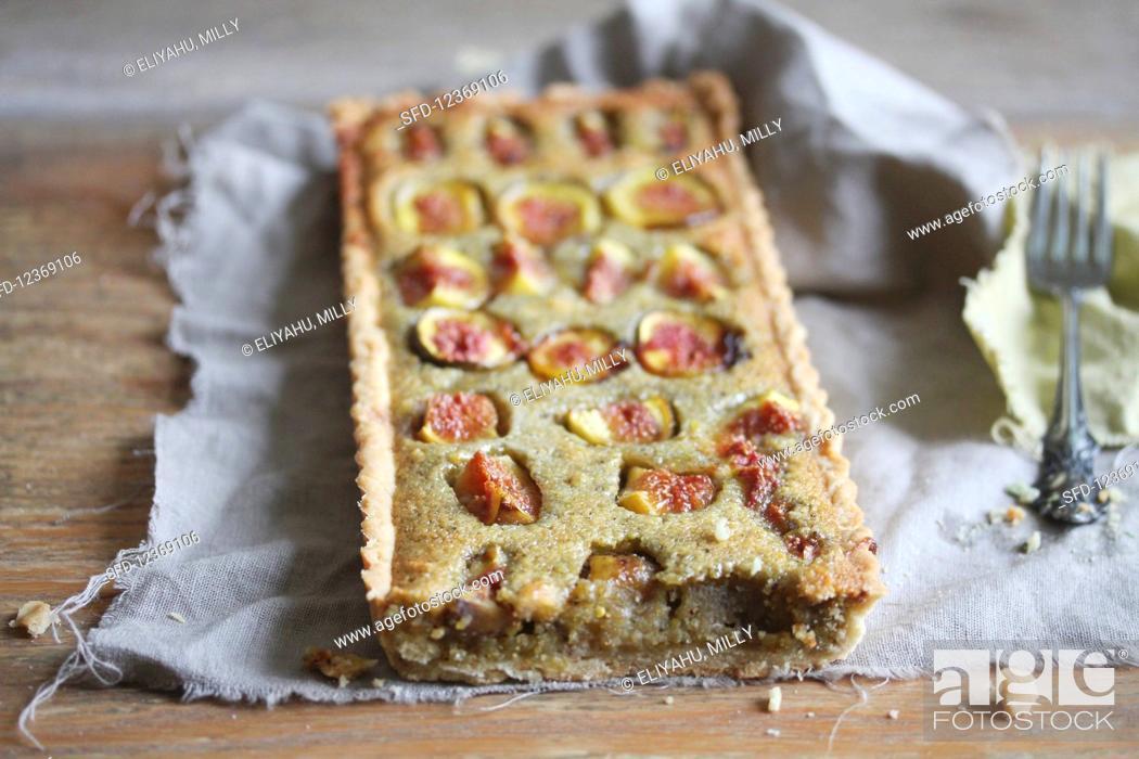 Stock Photo: Fig tart on a linen cloth.