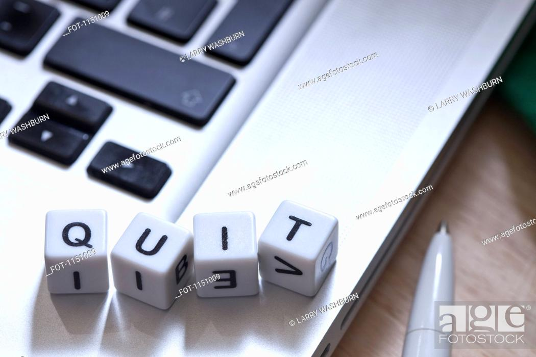 Stock Photo: Lettered cubes on a laptop spelling QUIT.