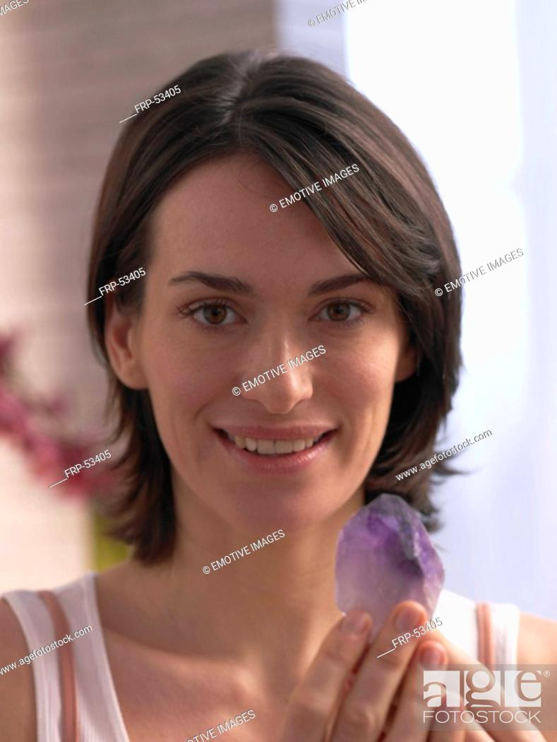 Stock Photo: Woman with amethyste in her hands.
