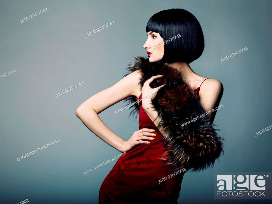 Stock Photo: Fashion portrait of a young beautiful dark-haired woman.